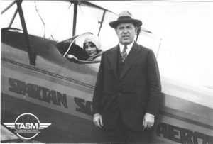 W. G. Skelly next to Airplane