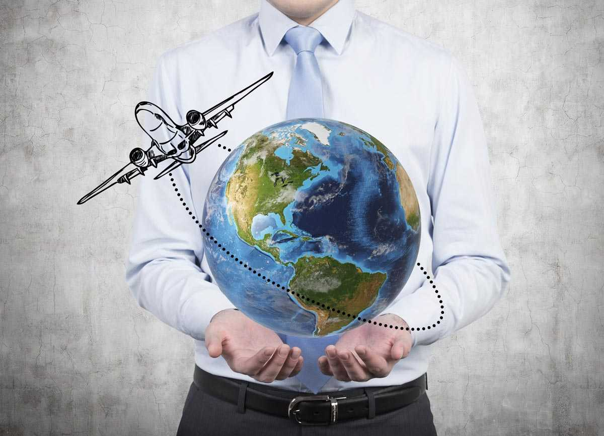 image of a man holding a globe with an airplane flying around it