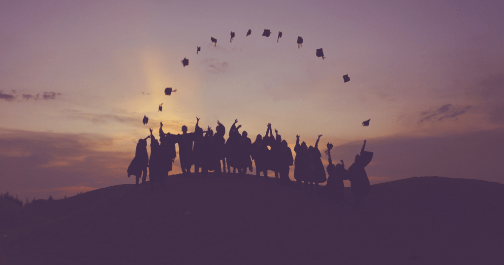 graduation photo with caps in the air