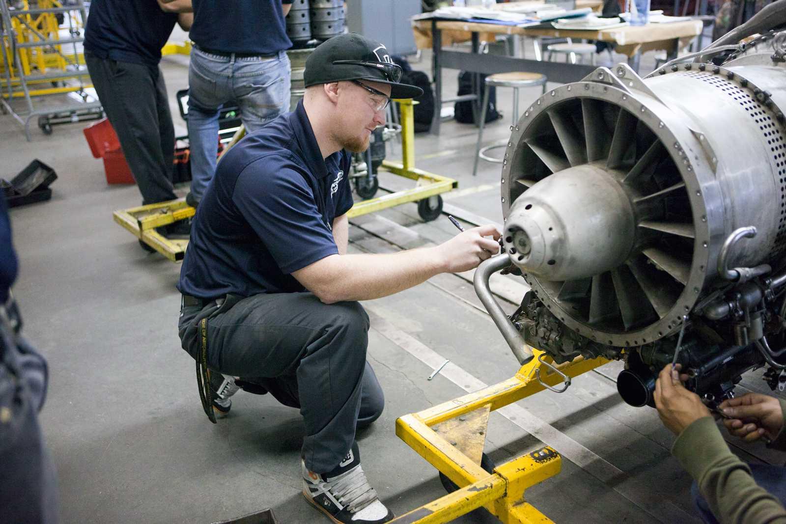 Spartan Student Working on Engine
