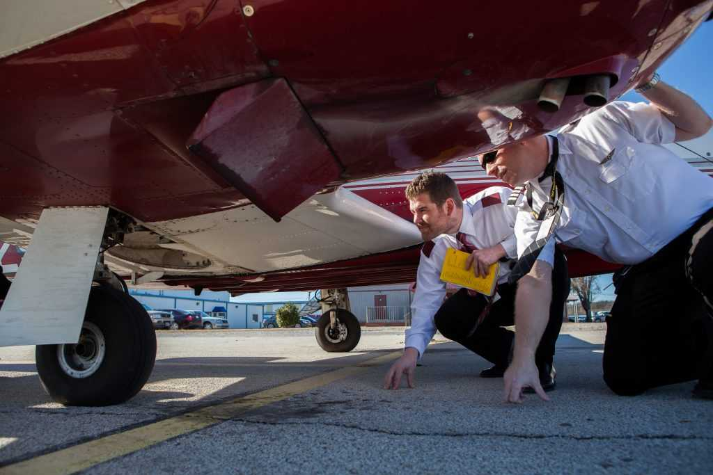 Students Inspecting Plane | Spartan College of Aeronautics and Technology