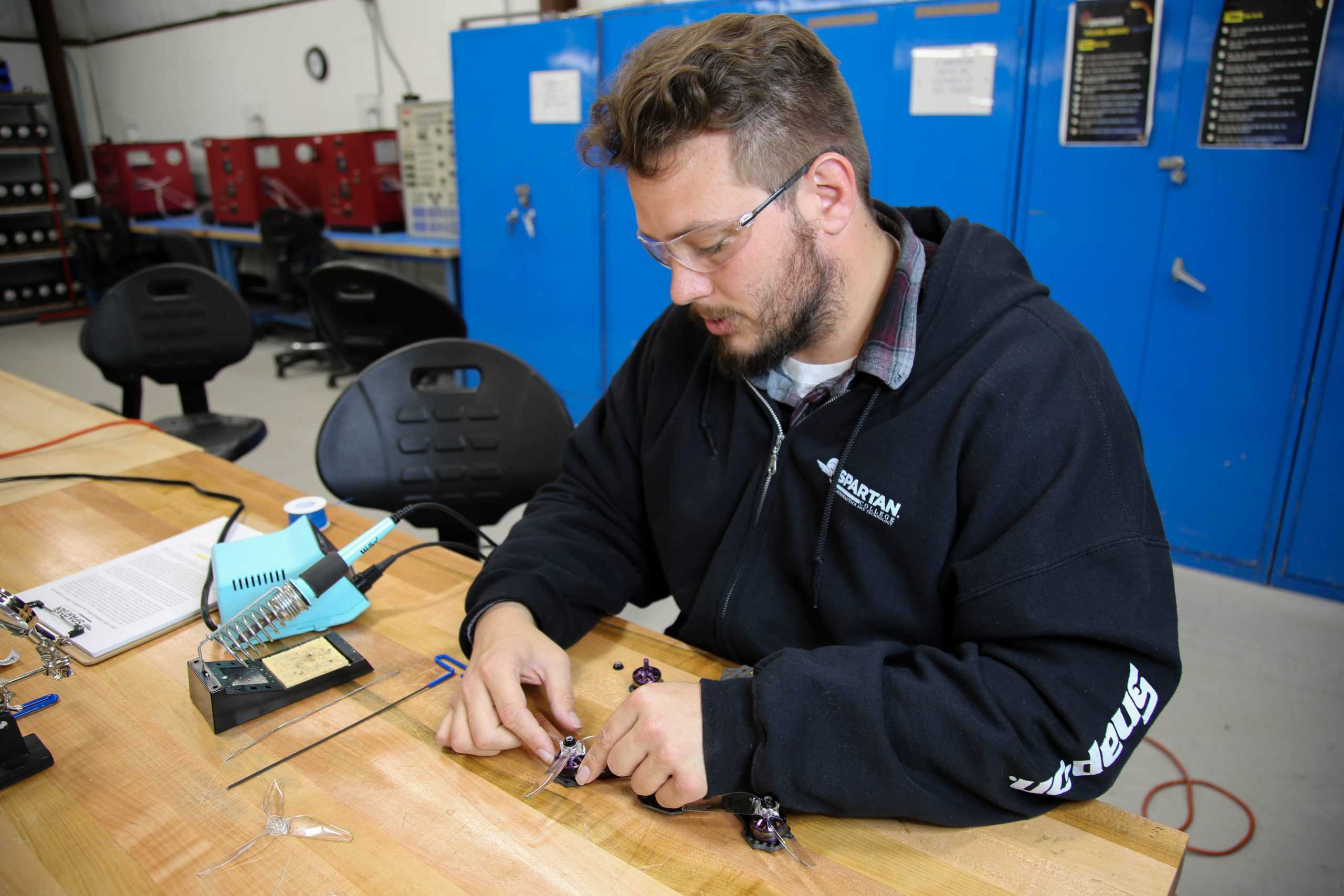 Aviation Electronics Technology student working in Tulsa