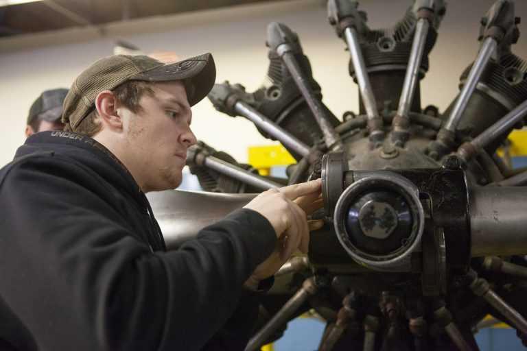 Tulsa AMT Hybrid Program student working on engine