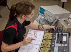 Woman working on digital systems in an AET program | Spartan College of Aeronautics and Technology