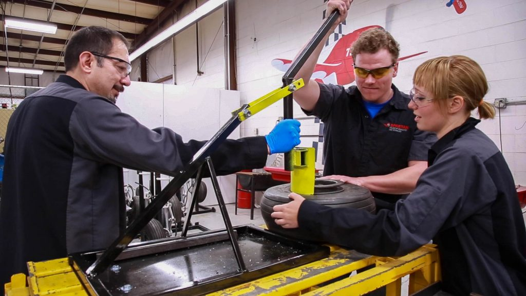 aircraft mechanic students working together | Spartan College of Aeronautics and Technology