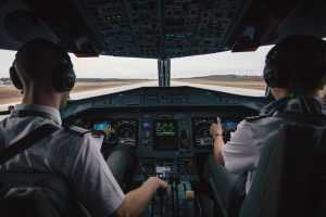 Pilots sitting in a cockpit on the runway