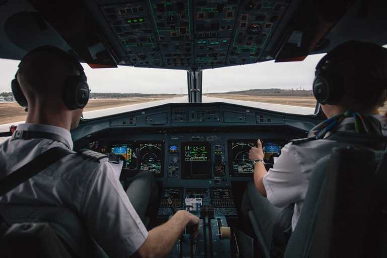 Pilots in Plane Getting Ready For Takeoff
