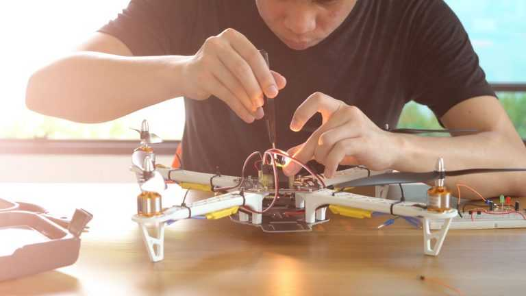 man working on avionics