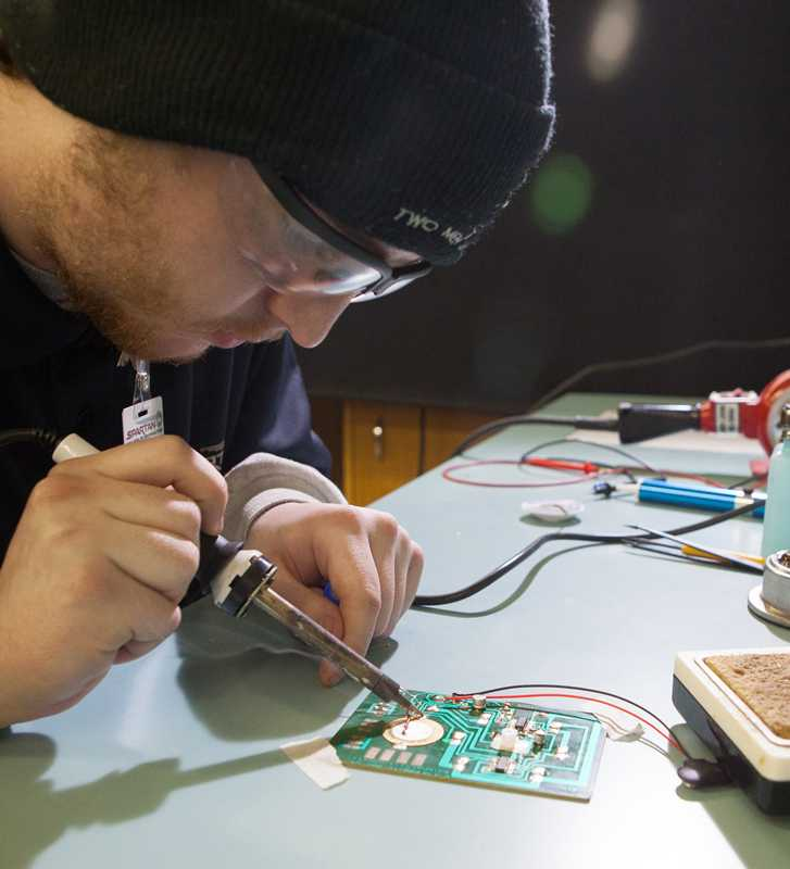 Avionics Technician Student-Soldering Circuit board Spartan College