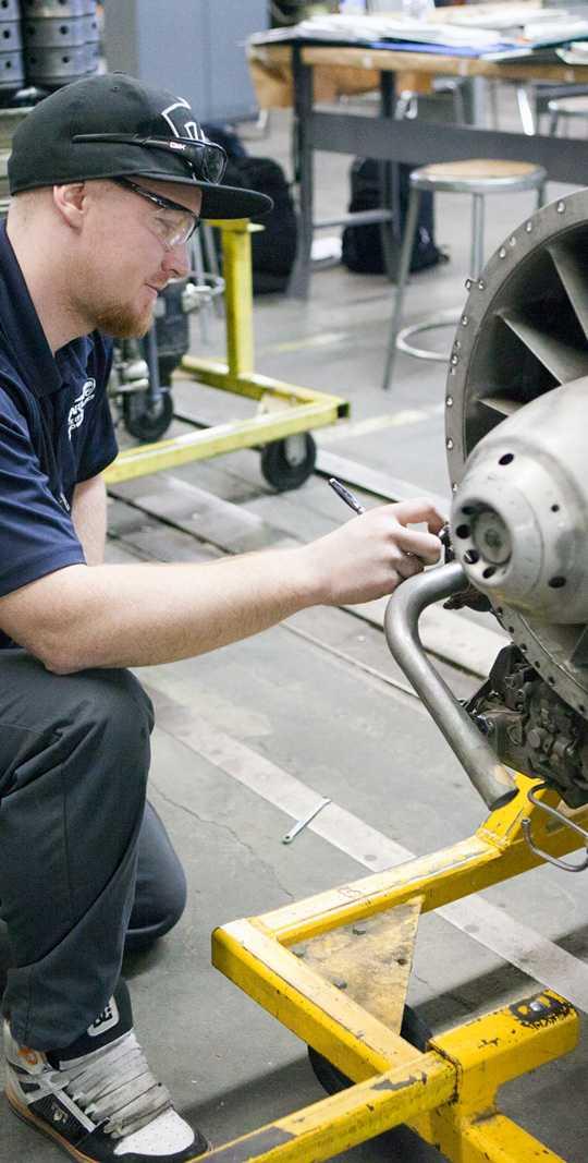 Guy Working on Engine Spartan College