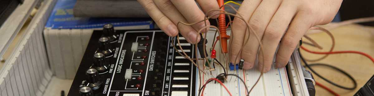 aet student working on a breadboard