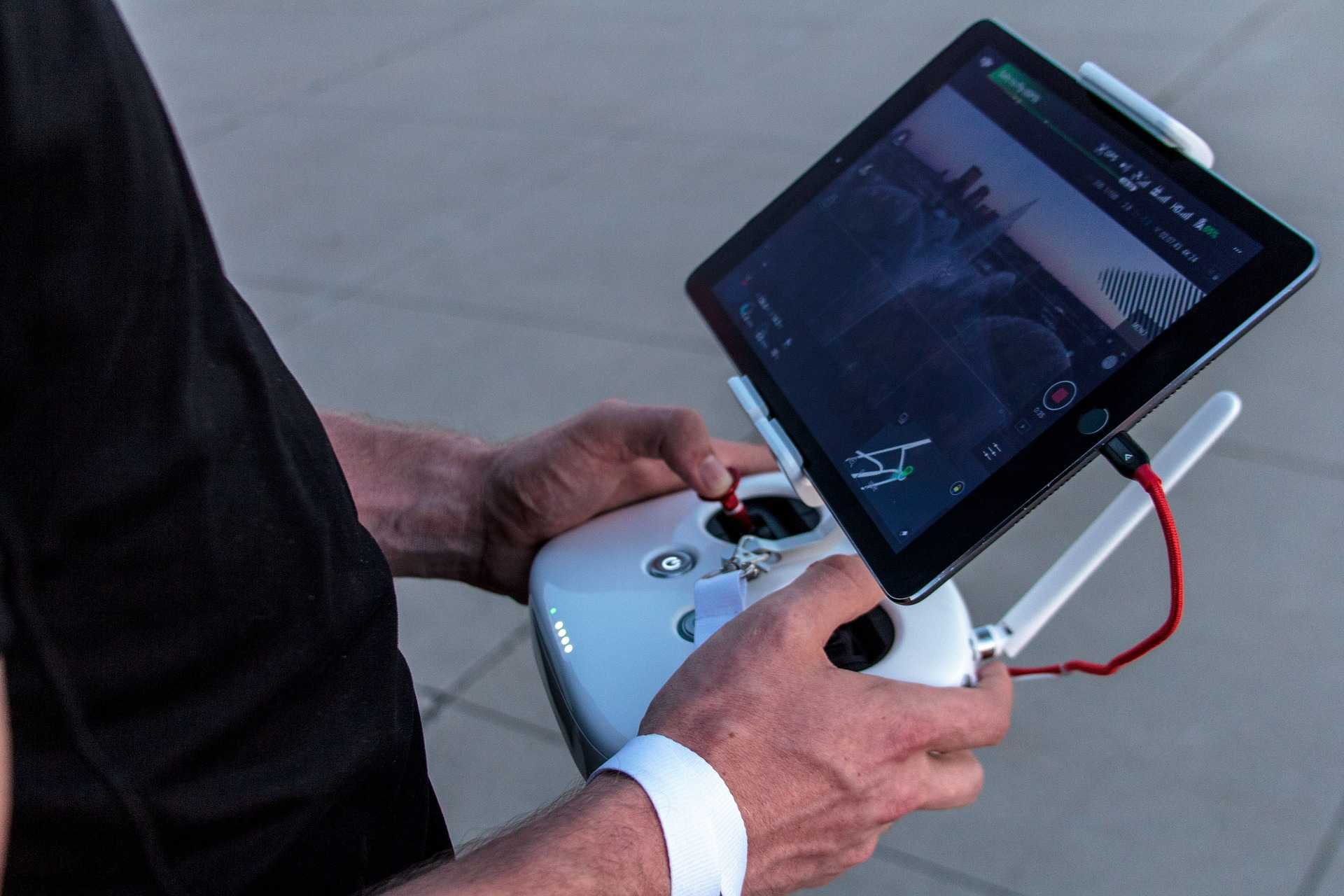 person using drone with video camera