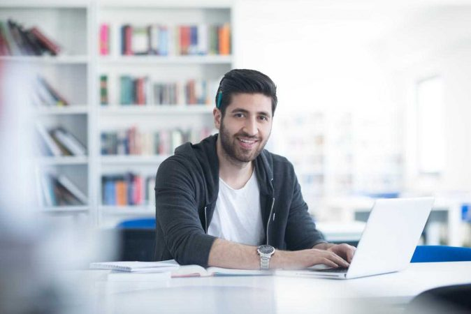 Spartan College - Man studying with Laptop